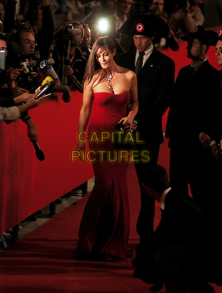 "MONICA BELLUCCI.Attends the Red Carpet Premiere of ""N (Io e Napoleone)"".during the Rome film Festival,.Rome, Italy, October 14th 2006..full length red dress interview press.Ref: CAV.www.capitalpictures.com.sales@capitalpictures.com.©Luca Cavallari/Capital Pictures."