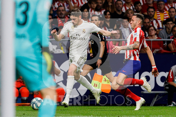 Jan Oblak (L) and Saul Niguez (R) of Atletico de Madrid and Fede Valverde of Real Madrid during La Liga match between Atletico de Madrid and Real Madrid at Wanda Metropolitano Stadium in Madrid, Spain. September 28, 2019. (ALTERPHOTOS/A. Perez Meca)