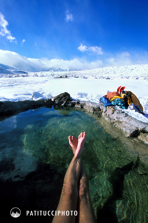 Janine Patitucci relaxing in a hot spring during winter. Eastern Sierra, Mammoth Lakes, California