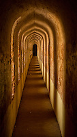 The walls of the Imambada building are a few meters thick and they house a dangerous labyrinth of secret tunnels that can prove to be deadly to a newcomer. Arched structures created acoustic capabilities that could transmit whispers from one point to another. Built to protect the Awadh king fromenemies in the 18th century. Lucknow, India