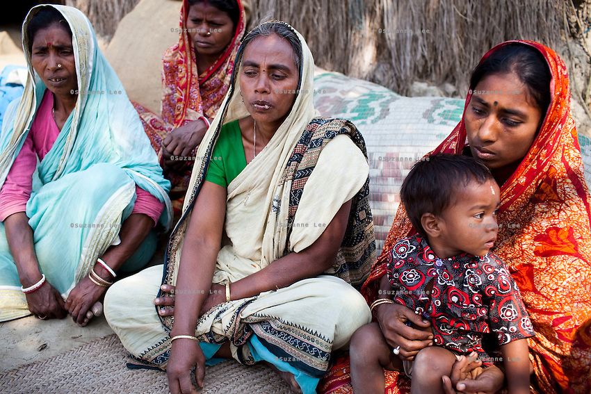 Widow Sumitra Mandol (center), 45, speaks of her husband's death as she sits outside her home on Gosaba island, Sundarban, West Bengal, India, on 18th January, 2012. While her husband was killed while hunting illegally in the sanctuary across the river, tigers have been known to swim, sometimes underwater, to the village to hunt humans. A successful Royal Bengal tiger breeding program has increased their numbers but decreased the number of husbands. There are now an estimated 3,000 widows in the villages where their husbands, have been killed by tigers. Photo by Suzanne Lee for The National (online byline: Photo by Szu for The National)