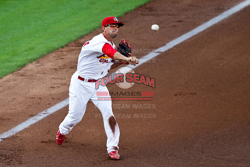 Jose Garcia (3) of the Springfield Cardinals throws to first base during a game against the Arkansas Travelers at Hammons Field on May 5, 2012 in Springfield, Missouri. (David Welker/Four Seam Images)