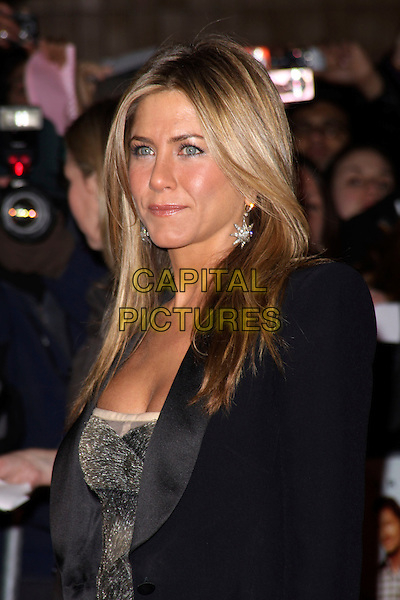 JENNIFER ANISTON .Attending 'The Bounty Hunter' UK film premiere at the Vue West End,cinema Leicester Square, London, England, UK. March 11th, 2010 .arrivals half length black jacket blazer silver metallic shiny dress grey gray dangling earrings tuxedo tux beaded.CAP/AH.©Adam Houghton/Capital Pictures.