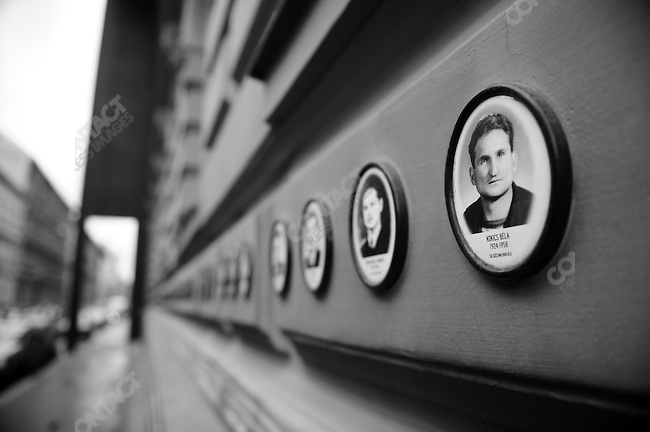 Portraits of those who lost their lives in the uprising of 1956 against Soviet influence adorn the Wall of Heroes on the House of Terror on Andrassy Road in Budapest, Hungary, March 24, 2008