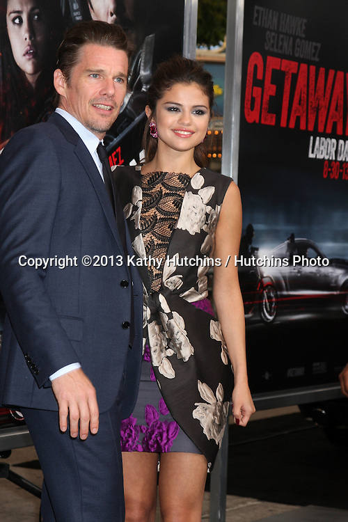 "LOS ANGELES - AUG 26:  Ethan Hawke, Selena Gomez at the ""Getaway"" Premiere at the Village Theater on August 26, 2013 in Westwood, CA"