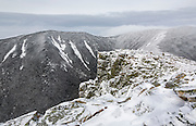 Looking across Hellgate Ravine at West Bond Mountain from the summit of Bondcliff in the Pemigewasset Wilderness of the New Hampshire White Mountains on a cloudy winter day.