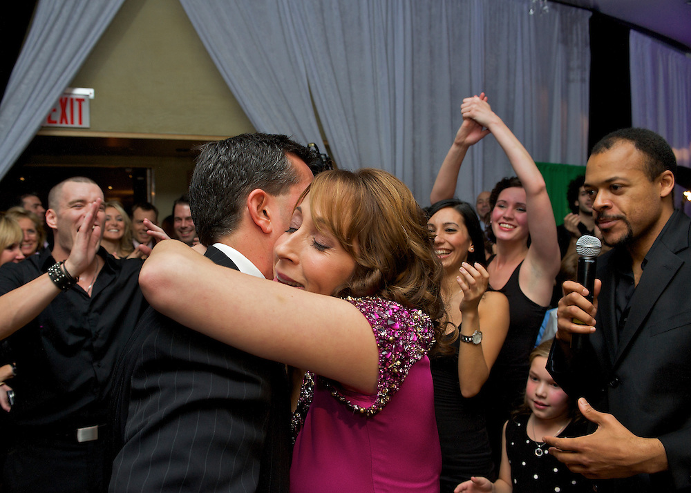 The parents embracing on the dance floor