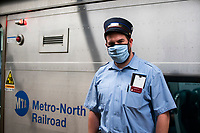 NEW YORK, NY - MAY 21:  A MTA worker poses for a picture at the tracks in Grand Central Terminal during the outbreak of the COVID-19 pandemic on May 21, 2020 in New York City. The number of transit workers killed by the coronavirus is at least more than 123, the agency revealed Wednesday. (Photo by Eduardo MunozAlvarez/VIEWpress)