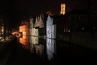 "BRUGES, BELGIUM - FEBRUARY 06 : A sidelong view of the Court of Justice buildings with the reflection in the waters of a canal by night on February 06, 2009 in Bruges, West Flanders, Belgium. The well-lit ""Beffroi"" (Belfort) appears on the top in the background. (Photo by Manuel Cohen)"