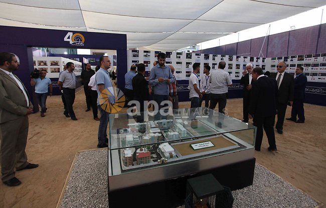 Palestinians attend an exhibition marking the 40th anniversary of the founding of the Islamic University, in Gaza city on August 19, 2019. Photo by Mahmoud Ajjour