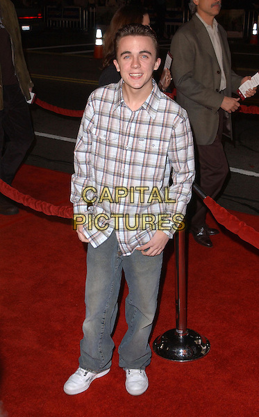 FRANKIE MUNIZ.Universal Pictures World Premiere of Along Came Polly held at the Grauman's Chinese Theater .*UK Sales Only*.12 January 2004.full length, full-length, denim jeans, checked shirt, trainers.www.capitalpictures.com.sales@capitalpictures.com.©Capital Pictures.