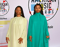 LOS ANGELES, CA - OCTOBER 09: Chloe Bailey (L) and Halle Bailey attends the 2018 American Music Awards at Microsoft Theater on October 9, 2018 in Los Angeles, California. <br /> CAP/MPI/IS<br /> &copy;IS/MPI/Capital Pictures