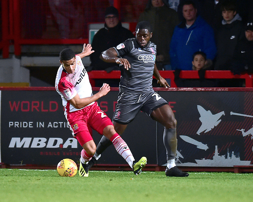 Lincoln City's John Akinde battles with  Stevenage's Luther Wildin<br /> <br /> Photographer Andrew Vaughan/CameraSport<br /> <br /> The EFL Sky Bet League Two - Stevenage v Lincoln City - Saturday 8th December 2018 - The Lamex Stadium - Stevenage<br /> <br /> World Copyright © 2018 CameraSport. All rights reserved. 43 Linden Ave. Countesthorpe. Leicester. England. LE8 5PG - Tel: +44 (0) 116 277 4147 - admin@camerasport.com - www.camerasport.com