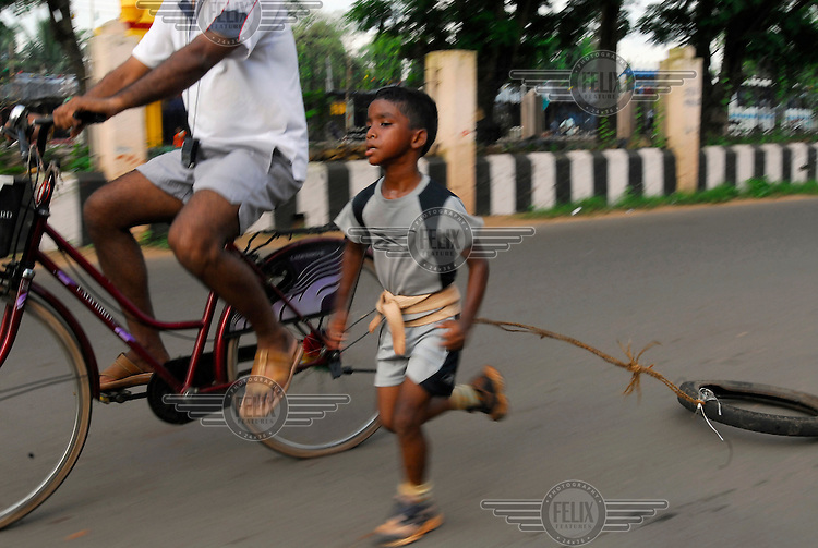 Four year old Budhia Singh, who has achieved a series of extraordinary athletic feats and become famous as the world's youngest marathon runner. As Budhia runs, his trainer Biranchi Das cycles alongside with a stopwatch.