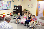 Children, from left to right, Will Ward, Moriah Harimon, Autumn Brawley and Ayden Brawley listen to Ray Shaffer as he leads them in song in Sunday School at First Baptist Church in Thermopolis, Wyoming August 21, 2011.