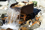 Holden ore cart from the old Holden Mine in upper Lake Chelan Valley is being used as a water feature at the entrance to the Hard Row to Hoe Winery in Manson, Washington.