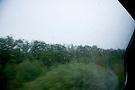 view from train with raindrops on the window