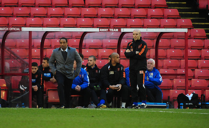 Blackpool's Manager Paul Ince, left, and Blackpool's assistant manager Alex Rae, right<br /> <br /> Photo by Chris Vaughan/CameraSport<br /> <br /> Football - The Football League Sky Bet Championship - Barnsley v Blackpool - Saturday 18th January 2014 - Oakwell Stadium - Barnsley<br /> <br /> &copy; CameraSport - 43 Linden Ave. Countesthorpe. Leicester. England. LE8 5PG - Tel: +44 (0) 116 277 4147 - admin@camerasport.com - www.camerasport.com