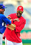 23 April 2010: Washington Nationals' center fielder Willie Harris kids with former teammate Ronnie Belliard prior to a game against the Los Angeles Dodgers at Nationals Park in Washington, DC. The Nationals defeated the Dodgers 5-1 in the first game of their 3-game series. Mandatory Credit: Ed Wolfstein Photo