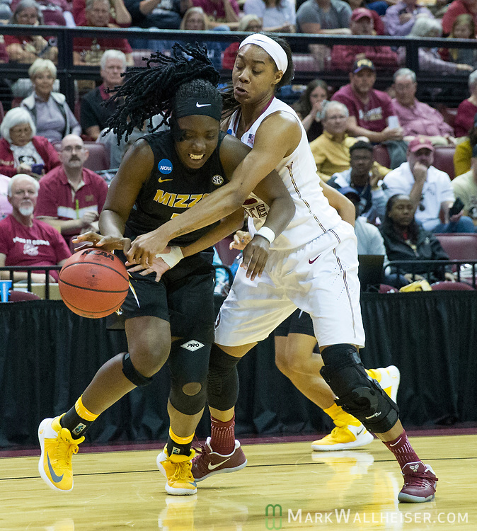 Florida State forward Ivey Slaughter tries to steal the ball from Missouri guard Amber Smith during the first half of a second-round game of the NCAA women's college basketball tournament in Tallahassee, Fla., Sunday, March 19, 2017. (AP Photo/Mark Wallheiser)