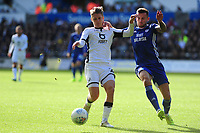 George Byers of Swansea City battles with Joe Ralls of Cardiff City during the Sky Bet Championship match between Swansea City and Cardiff City at the Liberty Stadium in Swansea, Wales, UK. Sunday 27 October 2019