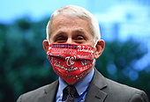 Director of the National Institute for Allergy and Infectious Diseases Dr. Anthony Fauci wears a Washington Nationals face mask when he arrives to testify before the House Committee on Energy and Commerce on the Trump Administration's Response to the COVID-19 Pandemic, on Capitol Hill in Washington, DC on Tuesday, June 23, 2020.    <br /> Credit: Kevin Dietsch / Pool via CNP