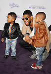 "{LOS ANGELES}, CA - {FEBRUARY} 08: Usher and children attend the ""Justin Bieber: Never Say Never"" Los Angeles Premiere at Nokia Theatre L.A. Live on February 8, 2011 in Los Angeles, California."