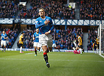Dean Shiels celebrates after scoring the opener for Rangers by thumping the Rangers badge on his shirt after been handed a start by Ally McCoist