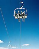 USA, Utah, two skiers on a chair lift at Deer Valley Ski Resort