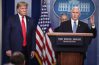 United States Vice President Mike Pence, right, speaks as US President Donald J. Trump listens during a press conference with members of the coronavirus task force in the Brady Press Briefing Room of the White House on March 24, 2020 in Washington, DC.<br /> Credit: Oliver Contreras / Pool via CNP/AdMedia