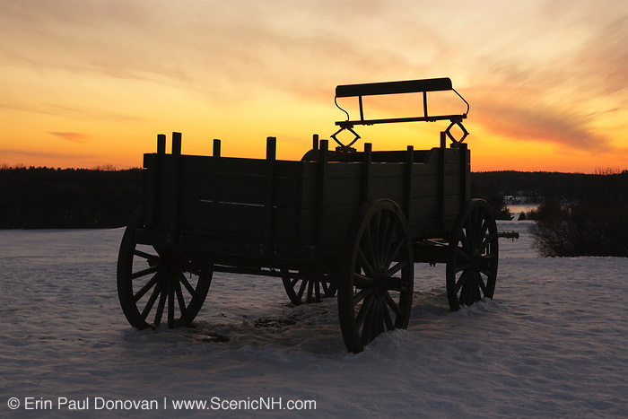 The silhouette of a wagon at Wagon Hill Farm in Durham, New Hampshire during the winter months.