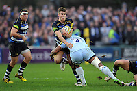 Ollie Devoto of Bath Rugby is tackled by Tevita Cavubati of Worcester Warriors. Aviva Premiership match, between Bath Rugby and Worcester Warriors on December 27, 2015 at the Recreation Ground in Bath, England. Photo by: Patrick Khachfe / Onside Images