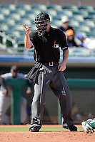 Home plate umpire Tom Woodring during an Arizona Fall League game between the Mesa Solar Sox and Scottsdale Scorpions on October 15, 2013 at HoHoKam Park in Mesa, Arizona.  Mesa defeated Scottsdale 7-4.  (Mike Janes/Four Seam Images)