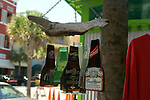 Flattened beer bottles and driftwood are the basis for a clever wind chime.