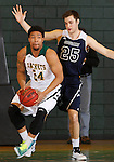 FEBRUARY 14, 2015 -- Yoshio Allen #24 of Black Hills State gets turned away by defender Joey Trinkle #25 of Colorado Christian during their Rocky Mountain Athletic Conference men's basketball game Saturday at the Donald E. Young Center in Spearfish, S.D.  (Photo by Dick Carlson/Inertia)