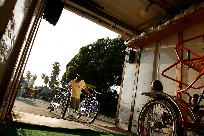 Paul Hefferich of Wheel Fun Rentals in Ventura, Calif., put his stock away for the night at the ventura Pier rental site on the evening of Sunday, April 23, 2006. (Photo by Bryce Yukio Adolphson/Brooks Institute of Photography, &copy; 2006)<br />