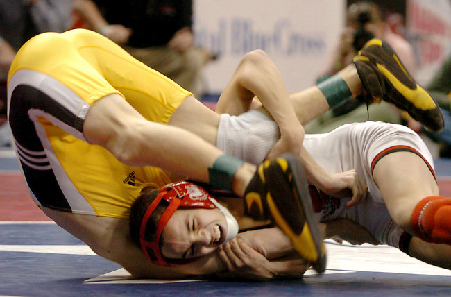 Easton's Jordan Oliver, bottom, wrestles Red Lion's Chris Albright, top, in the AAA 103 pound class quarterfinal round of the PIAA Wrestling Championship Friday, March 10, 2006, in Hershey, Pa. Oliver wins with a technical fall 25-10. (AP Photo/Bradley C Bower)