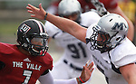 Lindenwood University - Belleville QB Anthony Dorsey (7, left) is about to be sacked by a Menlo Park player in the first half of their Homecoming Game against the Oaks.