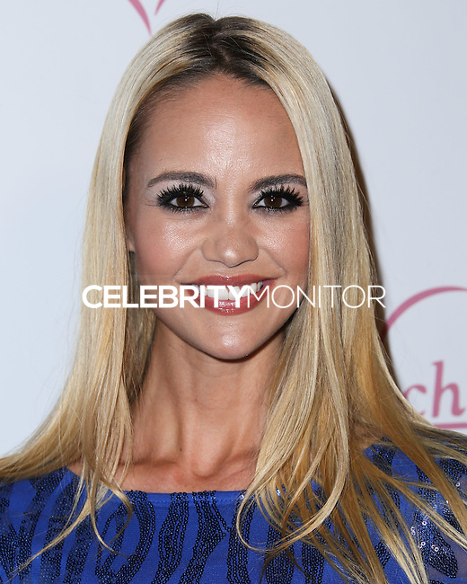 HOLLYWOOD, LOS ANGELES, CA, USA - AUGUST 28: April Scott arrives at the Benchwarmer Back To School Celebration to Benefit Children of the Night held at Station Hollywood at the W Hotel Hollywood on August 28, 2014 in Hollywood, Los Angeles, California, United States. (Photo by Xavier Collin/Celebrity Monitor)