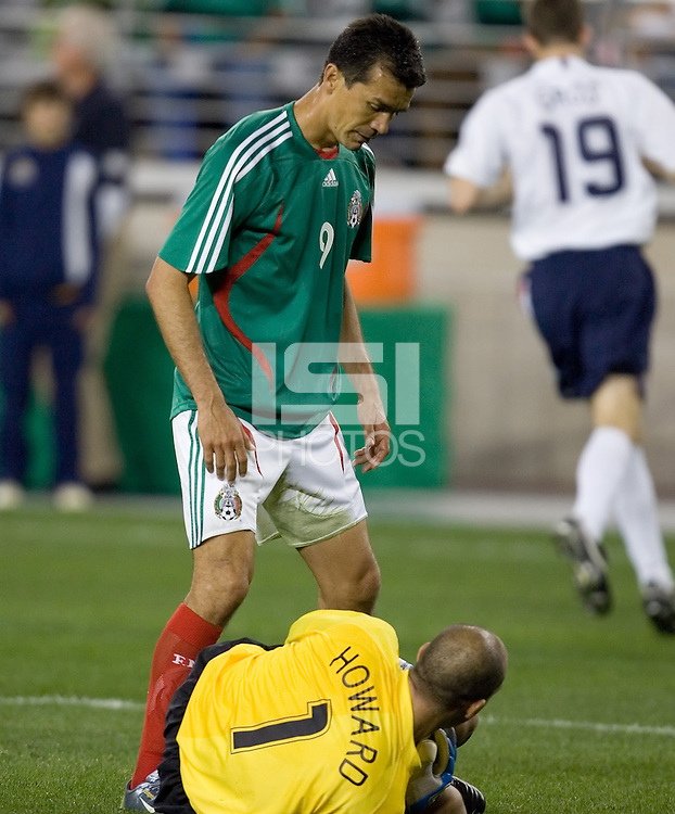 Mexico's Jared Borgetti stands over USA goalkeeper Tim Howard after he made a save. USA 2, Mexico 0, at the University of Phoenix Stadium in Glendale, AZ on February 7, 2007.