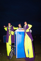Planning team members from the circus during the opening ceremony standing close to a toilet