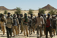 an SLA ( sudan liberation army) battallion squares up at the Amsiala base, not far from Kuthum in north darfur on Dec 2004