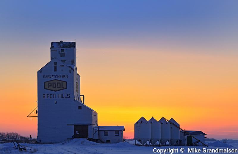 Grain elevator  and bins at sunset<br /> Birch Hills<br /> Saskatchewan<br /> Canada