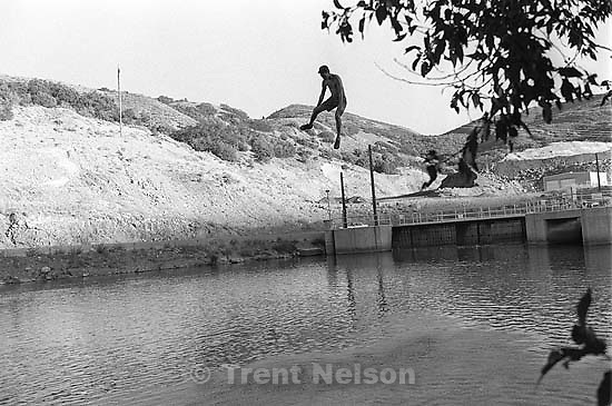 Trent Nelson on a rope swing.<br />