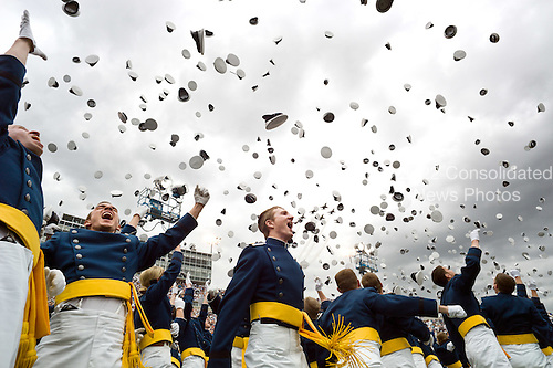 Newly commissioned second lieutenants throw their hats in the air during the commencement ceremony at the United States Air Force Academy in Colorado Springs, Colorado, May 23, 2012..Mandatory Credit: Chuck Kennedy - White House via CNP