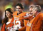 Texas Longhorns linebacker Dustin Earnest (42), a senior, meets with his parents on the field before the Texas A & M vs. Texas Longhorns football game at the Darrell K Royal - Texas Memorial Stadium in Austin, Tx. Texas A & M defeats Texas 24 to 17....