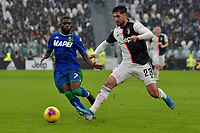 1st December 2019; Allianz Stadium, Turin, Italy; Serie A Football, Juventus versus Sassuolo; Jeremie Boga of Sassuolo and Emre Can of Juventus challenge for the ball - Editorial Use