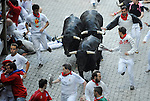 People run in front of Dolores Aguirre Ybarra´s fighting bulls during the second bull run in the San Fermin Festival on July 8 2014, in Pamplona, Basque Country. Every year, tens of thousands of people pack Pamplona's streets for a drunken kick-off to one os worls's best-known fiesta: the nine-day San Fermin bull-running festival. (Ander Gillenea / Bostok Photo)