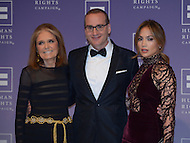 October 5, 2013  (Washington, DC)  Chad Griffin, president of the Human Rights Campaign, on the red carpet with Gloria Steinem (l) and Jennifer Lopez at the organization's 2013 national dinner.  (Photo by Don Baxter/Media Images International)