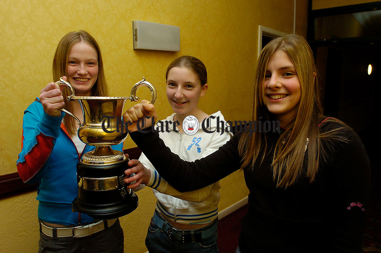 Sarah Mc Inerney, Oonagh Barry and Gemma Mc Inerney , members of  U-14 camogie team with their cup, at the Newmarket On Fergus Minor and Camogie Club's medal presentation and Disco in the Clare Inn Hotel. Photograph by John Kelly.